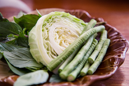 Vegetable morning glory and long bean for Famous Thai food, papaya salad or SOM TAM or Somtum. on wooden table. Stock Photo
