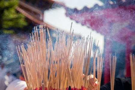 Burning Incense sticks in Temple Thailand Stock Photo
