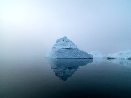 Arctic iceberg in a foggy day