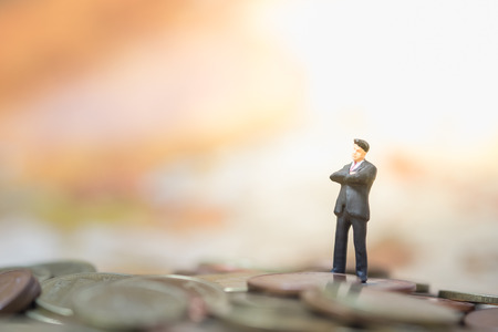 rate: Money, Financial, Business Growth concept, Businessman miniature figures stand and thinking to business plan on top of pile of coins
