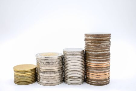 Money, Financial and saving concept. Close up of four type stack of coins on white background and copy space