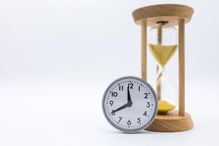 Time Management Concept. Vintage round clock with sandglass on white background and copy space for text.