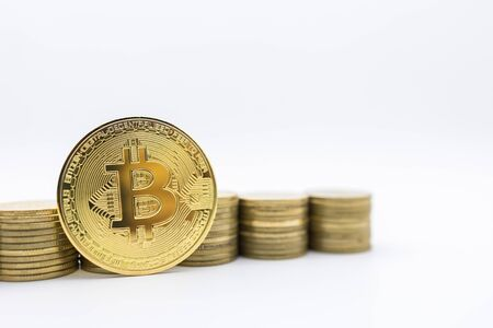 E-Commerce, crypto currency and Money Concept.  Close up of bitcoin coin with row of stack of gold coins on white background and copy spce for text.