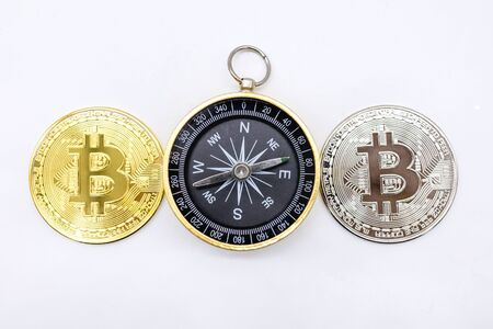 E-Commerce, crypto currency, Direction and Money Concept.  Close up of two bitcoin coin silver and coin)  with compass on white background and copy spce for text.