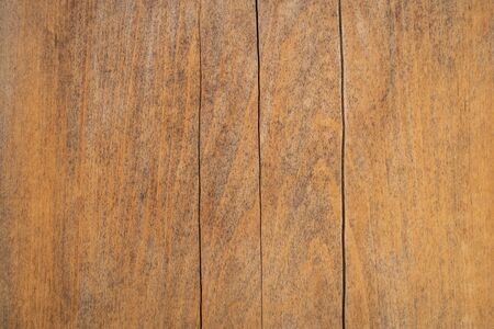 Close up of wooden plank with vertical crack. Using for texture background or wallpaper.