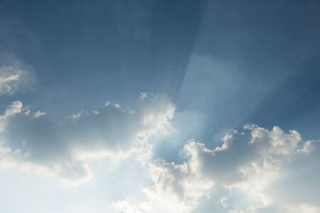 Clear blue sky with cloud and ray of sunlight. Use for nature wallpaper or background. Banco de Imagens