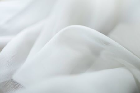 Close up of white linen cloth . Texture and fabric background or wallpaper.