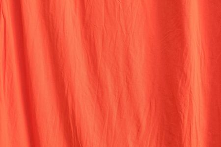 Close up of texture of orange red cloth using for fabric and textile wallpaper or background.
