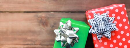 Cover for New Year, Christmas and Holiday Seasoning concept. Close up of colorful two gift box with beautiful ribbon on wooden plank with copy space.