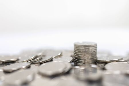 Business, Money, Finance, Security and Saving Concept. Close up of pile and stack of silver coins on white background and copy space.