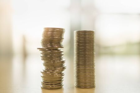 Business, Money Security and Saving Concept. Two stack of silver coins on wooden table. Фото со стока
