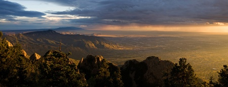 Panorama of majestic sunset over the Chihuahuan Desert and the city of Albuquerque, New Mexico, as seen from the peak of the Sandia Mountains photo