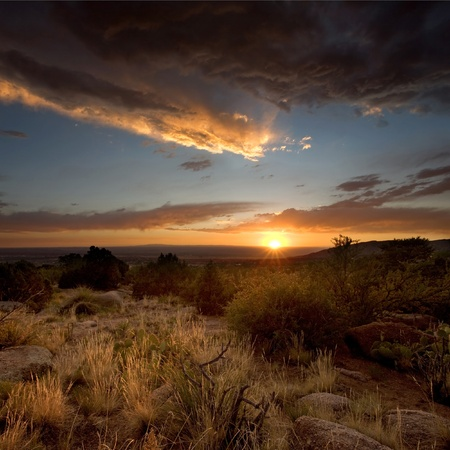 A majestic sunset over the Chihuahuan Desert at the base of the Sandia Mountains, outside of Albuquerque, New Mexico photo