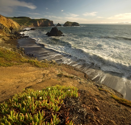 california beach: Photo of the cliffs at Rodeo Beach in the Marin Headlands near San Francisco in Northern California, at sunset