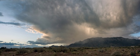 A giant storm passes over Albuquerques Sandia Mountains during monsoon season