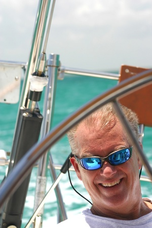 Middle aged man relaxing, sailing in tropical waters of Biscayne Bay Фото со стока