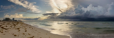 Panorama of a large, ominous storm approaching Miami Beach in early morning photo