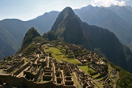 The ancient Incan ruin of Machu Picchu with Huayna Picchu in background photo