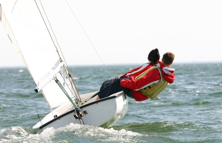 Two young dinghy sailors compete in regatta Stock Photo