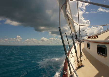 Sailing in the Florida Keys with a storm above but sunshine beind