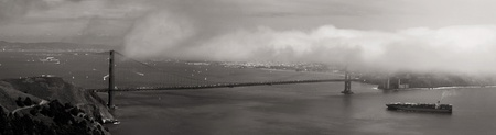 Golden Gate Bridge with fog rolling into San Francisco.  Alcatraz visible photo
