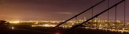 Downtown San Francisco and Bay Bridge, seen through Golden Gate Bridge  photo