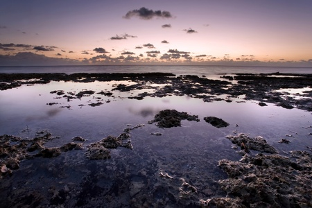 tides: Sunrise over rocky coastline and tide pools Stock Photo