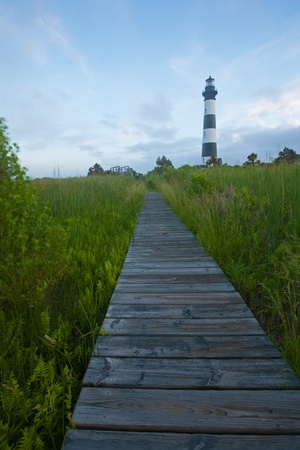 Boardwalk through swamp leading to Bodie Island Lighthouse, on the outer banks of North Carolina, near Nags Head photo