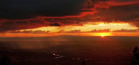 grande: Beautiful sunset over the Chihuahuan Desert and Rio Grande, from top of the Sandia Mountains