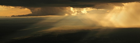 Panorama of dramatic stormy sunset on the Chihuahuan Desert of New Mexico