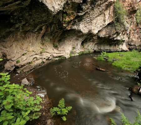 The Jemez River of New Mexico erodes into a cliff photo