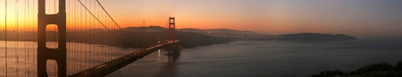 Panorama of beautiful sunrise over Golden Gate Bridge, San Francisco, California