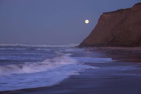 Half Moon Bay at moonset and sunrise coinciding photo