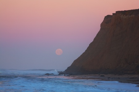 Moonset at sunrise at Half Moon Bay, California photo