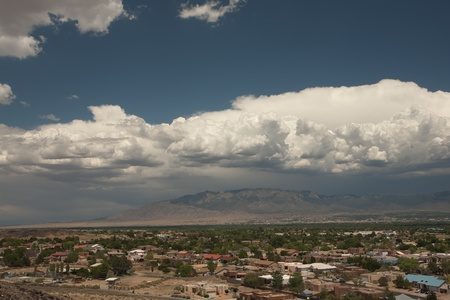 inclement: Large storm brewing over Albuquerque, New Mexico, with Sandia Mountains in background