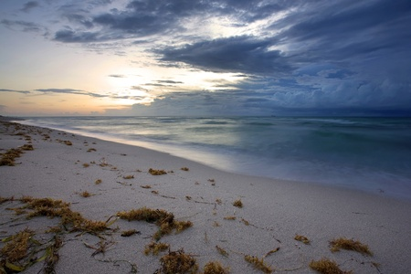 approaching: A large storm approaching Miami Beach during sunrise