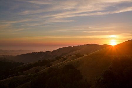 Beautiful sunset over the Santa Cruz Mountains of California with Pacific Ocean in background