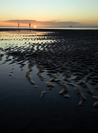 Beautiful tropical sunset over a sand bar at low tide photo