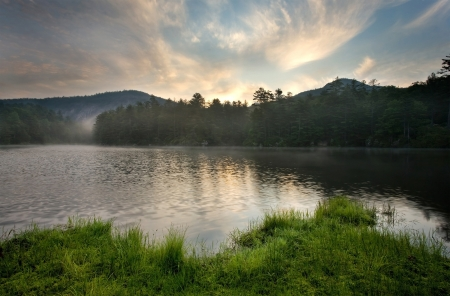 temperate: Fog evaporates from a lake at sunrise in a temperate rain forest, near Cashiers, North Carolina