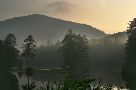 appalachian: A beautiful, misty sunrise on a mountain lake and golf course in North Carolina