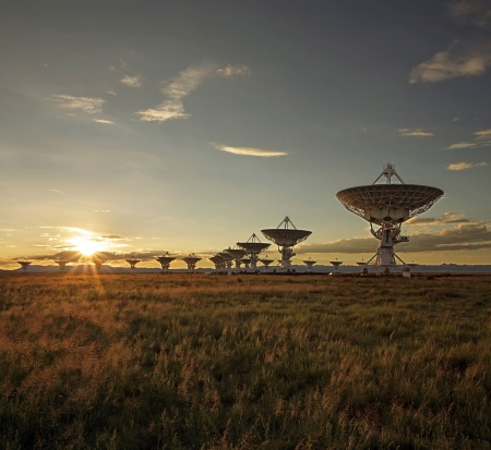 Satellite dishes in the Very Large Array in Socorro, New Mexico, at sunset photo