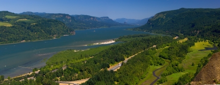 Beautiful panorama of Columbia River Gorge, separating Washington and Oregon, on a bright sunny day photo