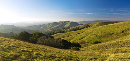 Rolling green hills and meadows on a sunny day in pastoral California Stock Photo