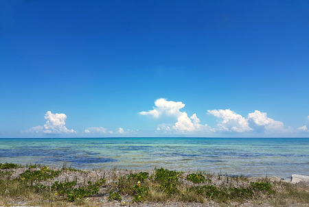 waters: Beautiful skies over shallow waters in the Florida Keys Stock Photo