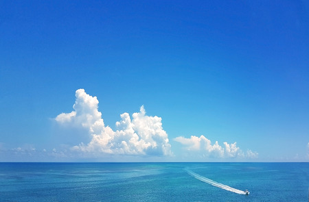 A lone motor boat has the ocean to itself, in the beautiful Caribbean water of the Florida Keys Stock Photo