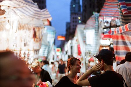 tourists enjoy shopping and experience the night market culture in Temple street of Hong Kong, photo is taken July 08
