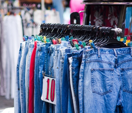 resale: used jeans on sale in local market, philippines, asia.  Stock Photo