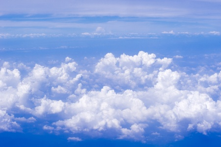 a view of sky, above of clouds.