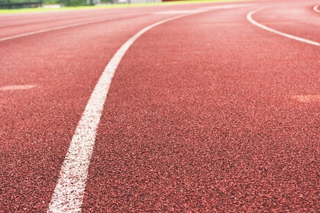 a close up of white line on red racetrack, for sports, concept background. photo