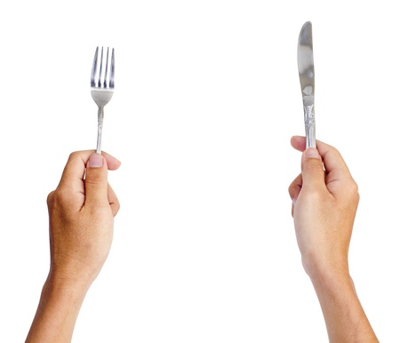 knife and fork: hands holding knife and fork, for dinning concepts. Stock Photo